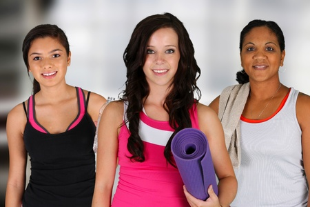 mats: Teen girl standing with her yoga mat at the gym