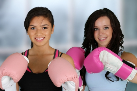girl kick: Teenage girls working out in the gym