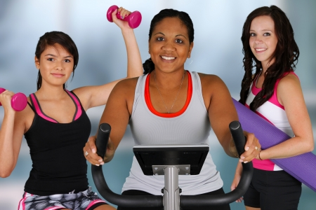 Group of women working out at the gym Stock Photo - 14715824