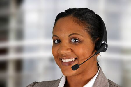 hotline: Young woman giving help as a customer service employee
