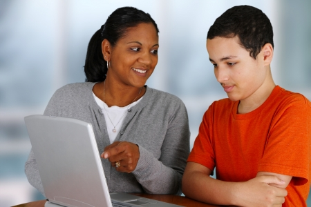 Teacher with her student in a classroom Stock Photo - 14747967