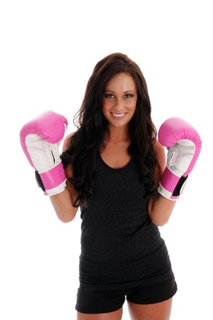 Woman boxing with a punching bag on white background 免版税图像