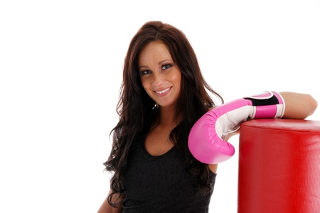 kickboxing: Woman boxing with a punching bag on white background Stock Photo