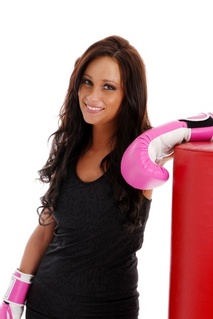 Woman boxing with a punching bag on white background photo