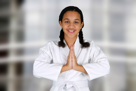 martial art: Teen girl doing karate at a studio
