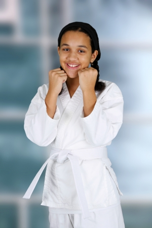 Teen girl doing karate at a studio