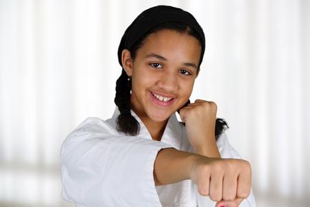 girl kick: Teen girl doing karate at a studio