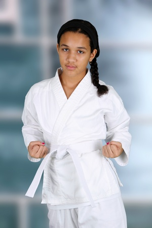 Teen girl doing karate at a studio photo