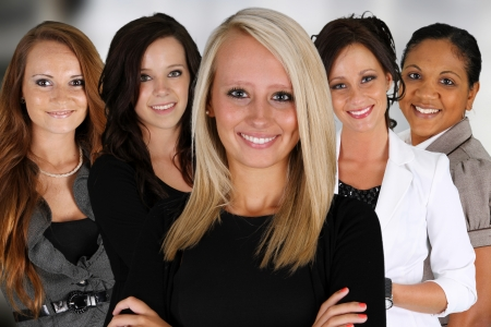 woman in white: Businesswomen of all races working together in an office