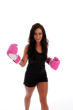 martial arts woman: Woman boxing with a punching bag on white background Stock Photo