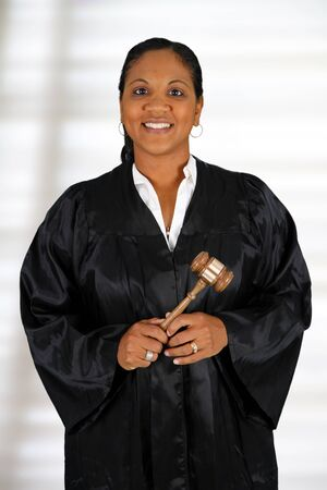 Woman judge standing up in the court room photo
