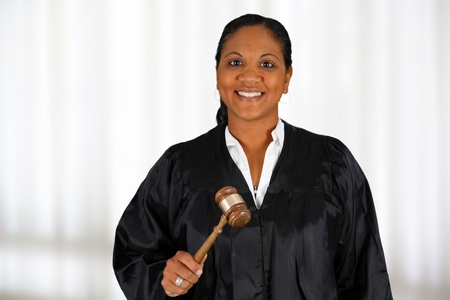 judge: Woman judge standing up in the court room