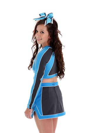 Teenage cheerleader with uniform on a white background Stock Photo - 14996545