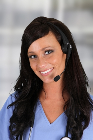 Young woman giving help as a customer service employee photo