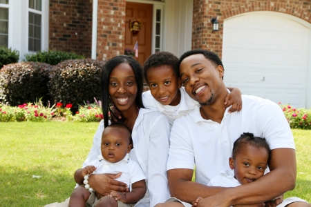 African American family together outside their home photo