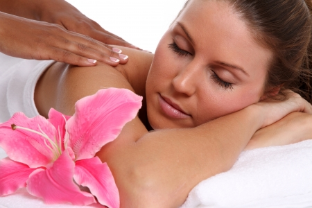 massage: Woman getting a getting relaxing massage in salon Stock Photo