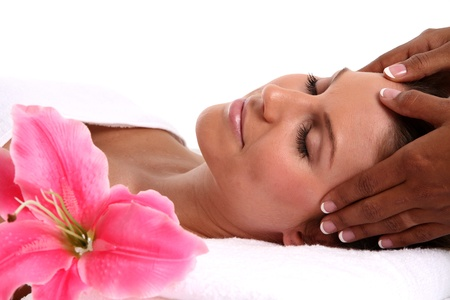 Massage therapy: Woman getting a getting relaxing massage in salon Stock Photo