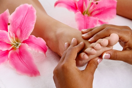 woman foot: Woman getting a getting relaxing massage in salon Stock Photo
