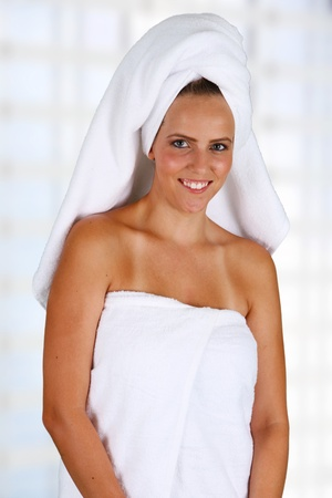woman in bath: Woman wrapped in a towel while at spa