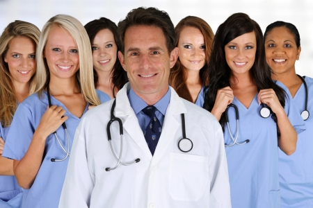 medical staff: Group of doctors and nurses set in a hospital Stock Photo