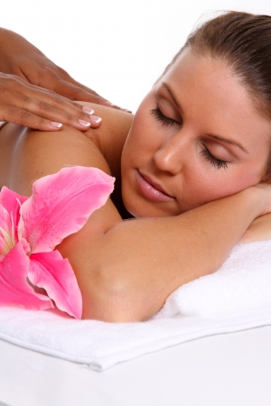 african american spa: Woman getting a getting relaxing massage in salon Stock Photo