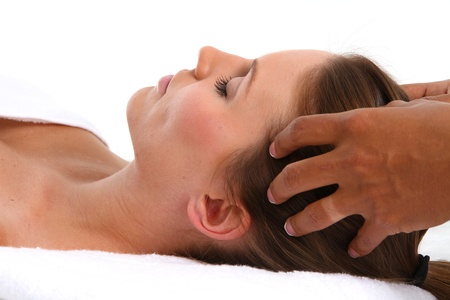 hair treatment: Woman getting a getting relaxing massage in salon Stock Photo