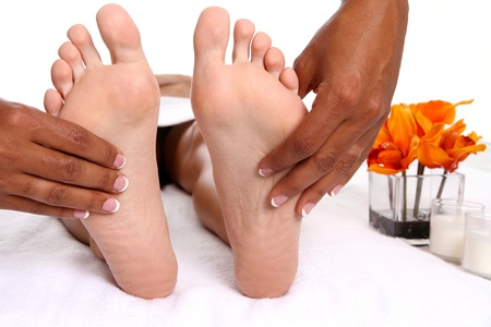 female feet: Woman getting a getting relaxing massage in salon Stock Photo