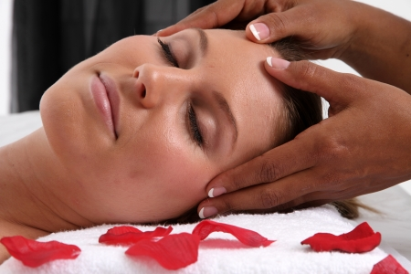 towel head: Woman getting a getting relaxing massage in salon Stock Photo