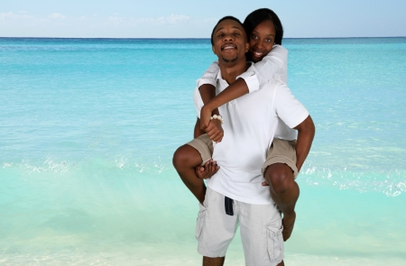 minority couple: Man and woman posing together at the beach Stock Photo