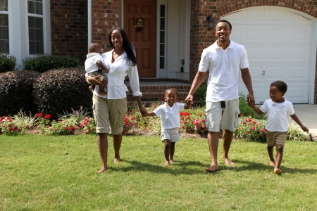 house wife: African American family together outside their home Stock Photo