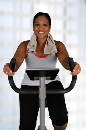 aerobic exercise: Woman working out while at a gym