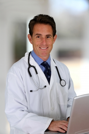 Caucasian male doctor working in a hospital Stock Photo - 17506493