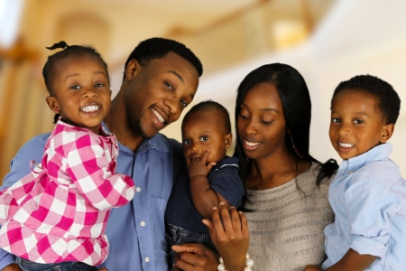happy african: African American family together inside their home