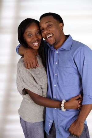 teen couple: Man and woman posing together inside their home Stock Photo