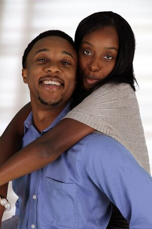 Man and woman posing together inside their home Stock Photo - 17573340
