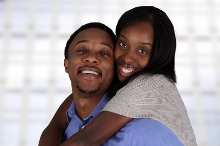 Man and woman posing together inside their home Stock Photo - 17573325