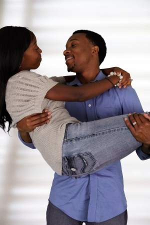 Man and woman posing together inside their home Stock Photo - 17573336