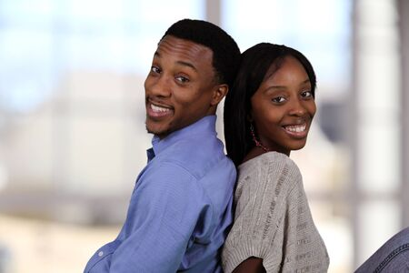 Man and woman posing together inside their home Stock Photo - 17573328