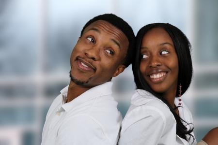 happy young: Hombre y mujer posando juntos en el interior de su casa Foto de archivo