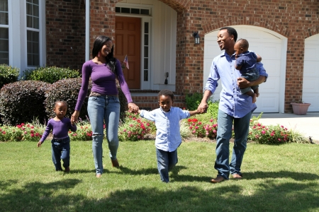 happy black woman: African American family together outside their home Stock Photo