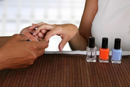 Woman getting her nails done at a spa photo