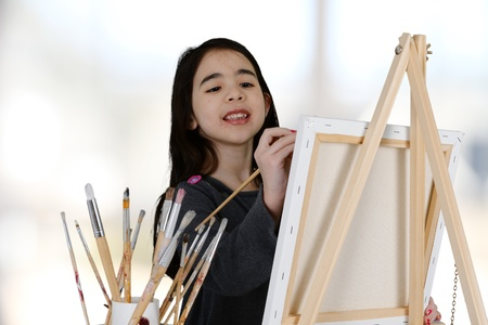Girl painting a canvas while at school photo