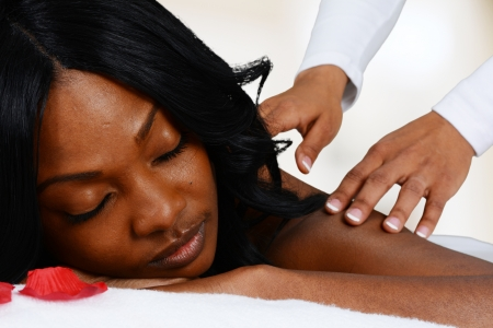 Woman getting a getting relaxing massage in salon Stock Photo