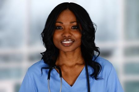 minorities: Minority nurse working at her job in a hospital