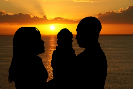 Family together outside at the beach silhouette photo