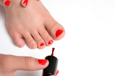 nails: Girl with her nails painted a red color Stock Photo
