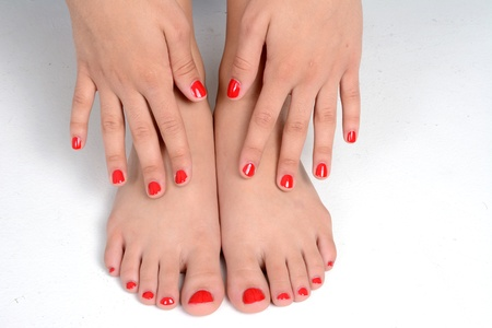 foot girl: Girl with her nails painted a red color Stock Photo