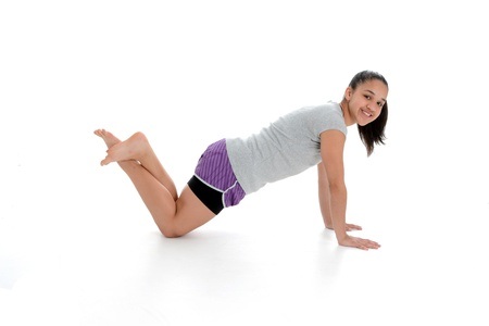 Girl Doing Yoga Pose in a Studio 스톡 콘텐츠