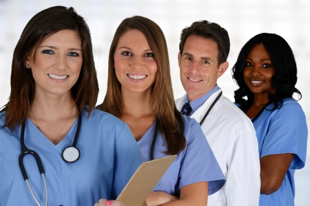 pielęgniarki: Grupa lekarzy i pielęgniarek ustawić w szpitalu Zdjęcie Seryjne