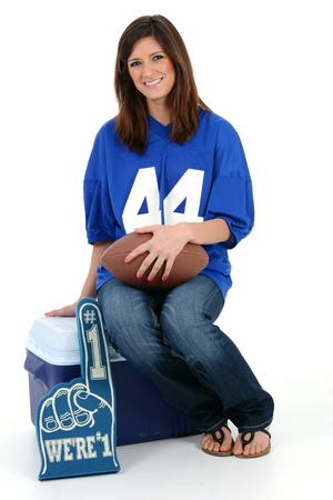 Adult womanl set against a white background with football Stock Photo - 19943827